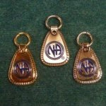 "Keychain Medallion Holders and Metal Key Tags NA Metal ""Decades"" Key Tag Lg."